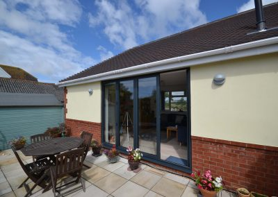 Side elevation with bifold doors of completed single storey kitchen and dining room extension