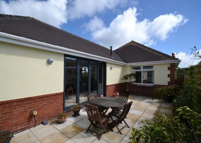 Side elevation and patio of completed single storey kitchen and dining room extension