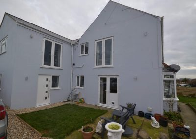 External side view of completed single and two storey extensions creating ancillary accommodation
