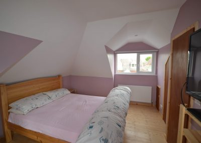 New bedroom and front dormer window in roofspace conversion