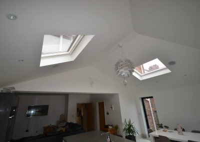 Internal view of completed of single storey kitchen and dining room extension showing vaulted ceiling and rooflights