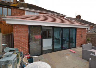 External rear view of completed of single storey kitchen and dining room extension showing multi fold doors