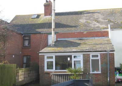 Rear elevation prior to construction of single and two storey extensions creating ancillary accommodation