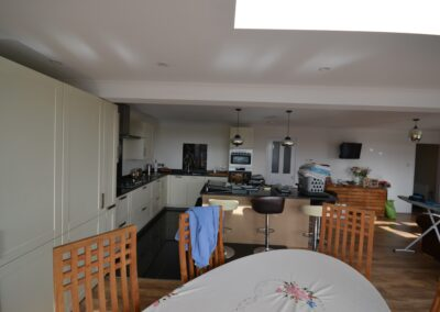 Internal view of new kitchen and dining room of single and two storey extensions creating lounge, dining room, kitchen and bedroom with en suite bathrooms