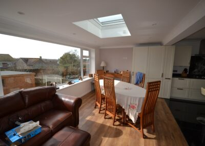 nternal view of new dining room and lounge of single and two storey extensions creating lounge, dining room, kitchen and bedroom with en suite bathrooms