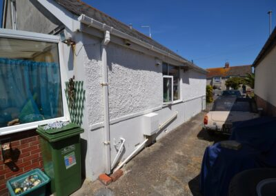 Rear side view prior to construction of two storey lounge, utility room and bedroom extensions