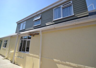 External side view showing cladding to dormer window of completed two storey lounge, utility room and bedroom extensions