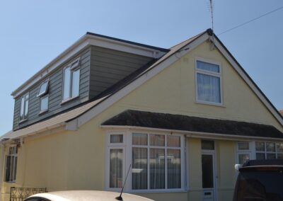 External front view showing cladding to dormer window of completed two storey lounge, utility room and bedroom extensions