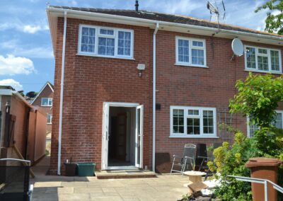 Rear view of completed two storey extension creating lounge, utility and bedroom with en suite bathroom