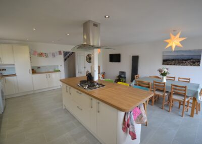 Internal view of completed kitchen and dining room of two storey kitchen, dining room and bedroom extensio